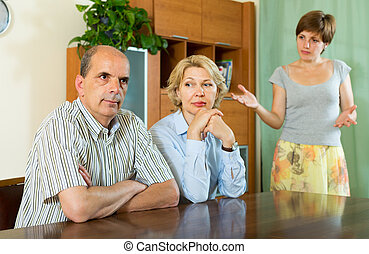 Adult daughter talking with parents - Adult daughter having...