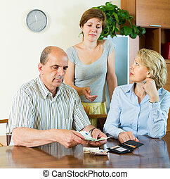Daughter asking parents for money - Senior family couple...