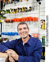 Happy Worker In Hardware Shop - Portrait of happy mature...