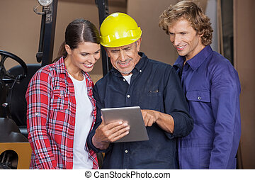Male And Female Carpenters Using Digital Tablet - Happy male...