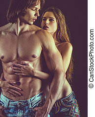 Beautiful young couple in love - Photo of a topless young...