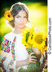 Girl with sunflowers - Young girl wearing Romanian...