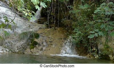 waterfall in the bushes in the river Lentej in Granada