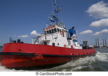 Harbor Tugboat - Red Harbor Tugboat cruising under a blue...