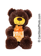 Bear with gift - Smiling teddy bear holding gift in paws,...