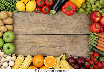 Fruits and vegetables on wooden board with copyspace