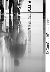 People walking - View of some walking reflected persons on a...