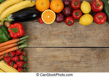 Fresh fruits and vegetables on wooden board with copyspace