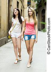 girls walking through European city - girls walking through...