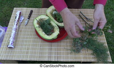 preparing zucchini for cooking in summer garden