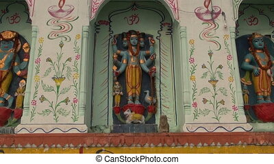 hinduism gods statue on temple wall in sacred Varanasi near...