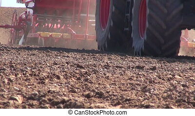 tractor with seed drill seeding