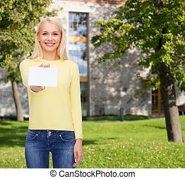 smiling girl with blank business or name card - happiness...