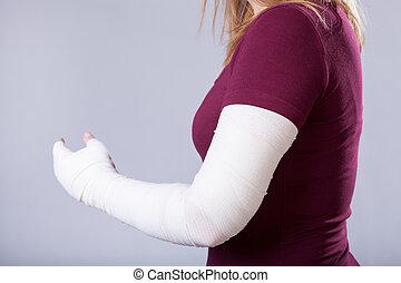 Broken arm - Closeup of young girl with broken arm