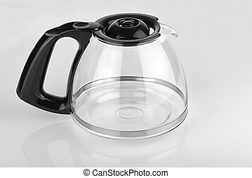 Empty coffee pot on a glossy white table - a empty coffee...