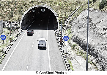 tunnel on the highway - cars circulating in the entrance of...
