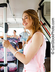 smiling teenage girl going by bus - travel, vacation,...