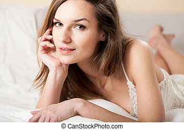 Sensual girl in bed - Horizontal view of sensual girl in bed