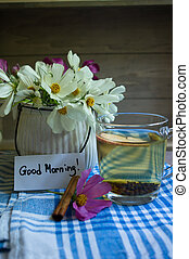 Summer time interior - Coreopsis flowers in a vase and cup...