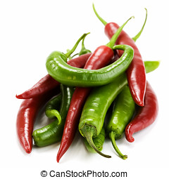 red and green chillis - macro photo of a bunch of red and...