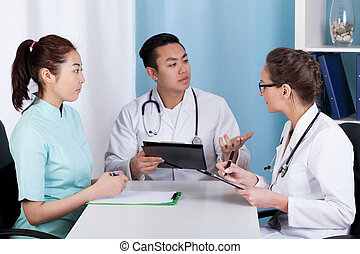 Doctors during morning meeting before job, horizontal