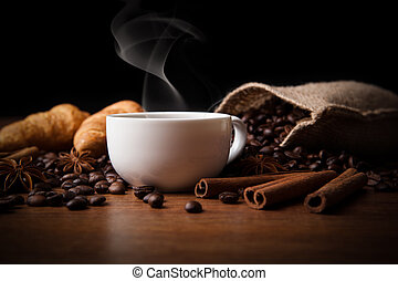 coffee still life - cup of black coffee with fume and...