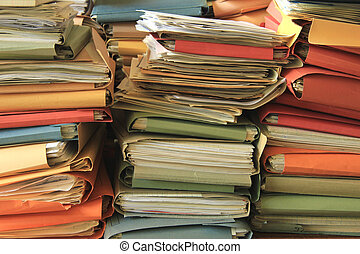 Stacked files - Stacked office files: pile of paperwork in...