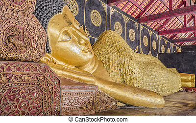 Reclining Buddha gold statue in temple of Thailand. -...