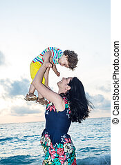 Happy family at sea - Happy family ogf mother and toddler at...