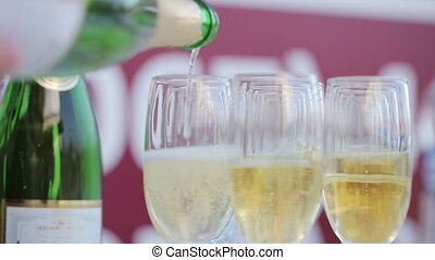 Bottling champagnes - Champagne poured into glass cubs