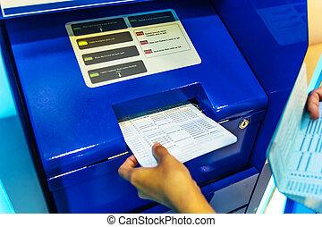 Saving deposit passbook Updating - Hand on Saving deposit...