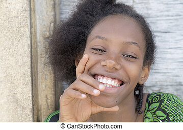 Natural Afro beauty smiling - Natural Afro beauty seated in...