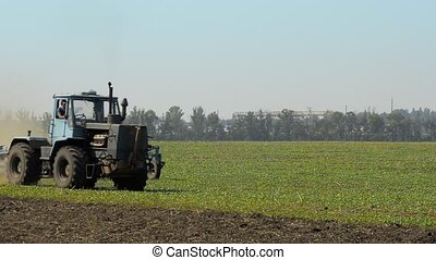 Tractor Plowing The Summer Field