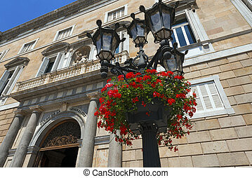 Flowers on Lamp Post - Barcelona Spain - Red geraniums on a...