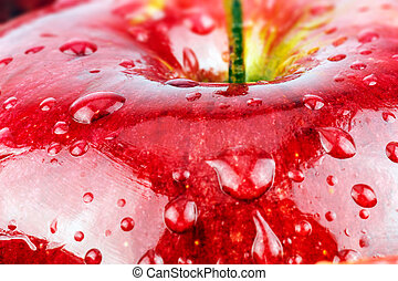 Macro of fresh red wet apple with water drops