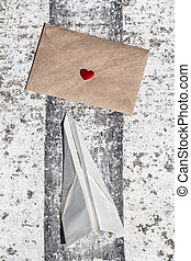Airmail Love Letter - Love letter and paper toy plane at the...