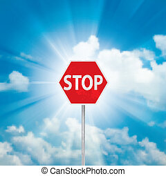 Stop Sign and blue sky with clouds