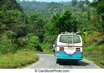 Bus on road in Annapurna Valley between go to Pokhara Nepal