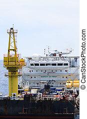 Helicopter landing on offshore oil rig, Passenger transfer...