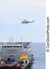 Helicopter landing on offshore oil rig, Passenger transfer...