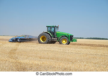 tractor with a plow - The image of a tractor with a plow