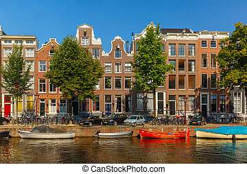 City view of Amsterdam canals and typical houses, boats and...