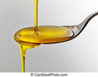 pouring cooking oil - cooking oil pouring into spoon