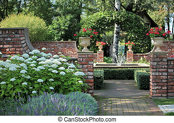 English garden with a fountain - spray fountain in the rose...