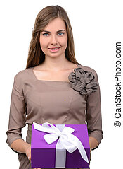 Gift - Young, happy woman holds a box with a gift, isolated...