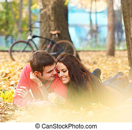 Happy young couple in autumn park - Happy young couple with...