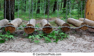Obstacle course in the forest - Side view of outdoor action...