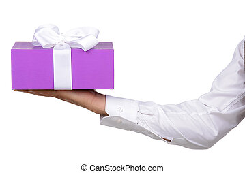 Gift - Young man holds a box with a gift, isolated on white...