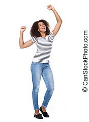 Cheerful young woman with arms raised