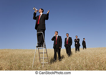 Speaker opportunity - a group of businessman in the field...